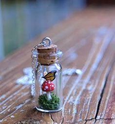 Toadstool and butterfly in a jar necklace.