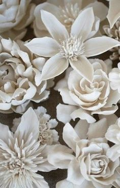 Vladimir Kanevsky's Porcelain Flowers were featured in the Wall Street Journal. His floral pieces are so reminiscent of the real thing because he includes the natural bend here, a torn petal there. Absolutely stunning!