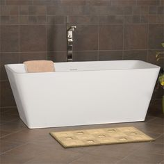 """59"""" Kelem Freestanding Resin Tub love that the spout is in the middle of the tub"""