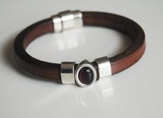 Mens Brown Licorice Leather Bracelets - leather Bracelets- Mens jewelry- Mens Bracelets- Brown bracelets. Beautiful brown 10x6mm licorice leather bracelets accented with silver plated spacer with tiger eye stone. magnetic closer for easy opening and closing. Bracelet measure 7 1/2 inside diameter. If you need other size please let me know. Please visit my other womens jewelry shop; - www.ferozasjewelery.etsy.com