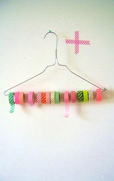 DIY Washi tape, ribbon organizer idea using a wire hanger or coat hanger.