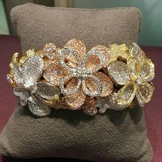"The flowers are definitely blooming in Kwiat's ""Lotus"" diamond bracelet in 18K rose, yellow and white gold and set with 18.80cttw in diamonds! Truly a work of art!! #kwiatdiamonds"