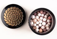 """Guerlain Perles du Dragon Meteorites ($58.00 for 1.05 oz.) is a """"harmony of six shades of pearls in an intense, iridescent monochrome palette."""">>  Cloak the face in incredible radiance w/ pale pink and beige to even out the complexion, and white and gold to illuminate, plum and rosewood to brighten."""