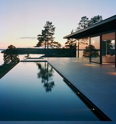 infinity pool and glass house