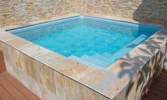 Simple clean lines highlight this plunge pool/hot tub. You can build this yourself and save a ton of money. Visit, www.custombuiltspas and let us show you how.