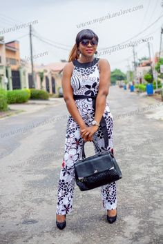 Monochrome Jumpsuit, Ankara Jumpsuit, African Print Jumpsuit by MyAnkaraLove on Etsy  Black and white has never looked any better in this monochrome asymmetric neckline jumpsuit with just the right touch of red made from 100% cotton print fabric. Jumpsuit ordered will be just as pictured.   www.etsy.com/myankaralove