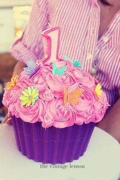 Giant cupcake cake, flowers, butterflies, rosettes, pink, purple