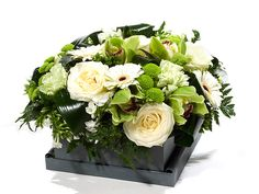 Akito modern flower creation with beautiful white roses, green orchids, hypericum berries and extraordinary vegetal materials. Delivered daily in the Netherlands by GiftsforEurope. White Lilies, White Roses, Red Roses, Fresh Flowers, Beautiful Flowers, Green Orchid, Christmas Flowers, Original Gifts, Tulips