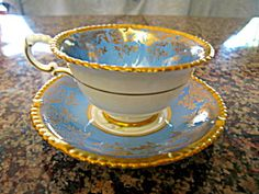 Paragon Queen Mary teacup with gold trim. For sale at More Than McCoy at www.morethanmccoy.com