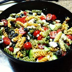Pasta salad: tri colored pasta, feta cheese, cherry tomatoes, cucumber,       black olives, fat free Italian dressing, pepper. Delish
