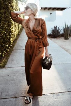 """Jacey wears satin robe, and Cult Gaia ark bag Stephanie wears duster jacket, jeans and shoes """"This trend makes me feel so sexy – even if I am hidden underneath"""
