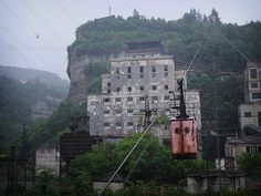 Credit: Amos Chapple/Rex Features The cable car makes its way up the cliff against a backdrop of disused industrial buildings