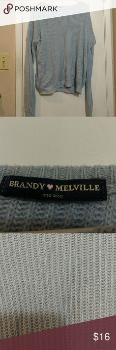 Brandy Melville Blue Ollie Sweater This is a reposh, it turns out Brandy sweaters are just too oversized on me! It was in great condition when I purchased, I wore it once and unfortunately my kitten made a small pull on the left sleeve. This is the only flaw. Brandy Melville Sweaters Crew & Scoop Necks