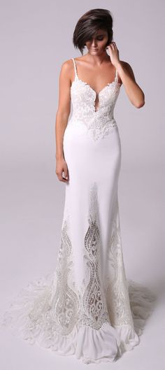 skin tight mermaid gown with a plunging V neckline and a low back at the behind #marriage of two embroidered laces fit and flare wedding dress : Michal Medina #weddingdress #weddingdresses