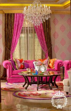 This fushia inspired living room is so tastefully done!  Look at that wallpaper!