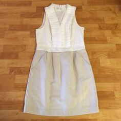"""Ruffled V-neck LOFT dress White Ruffled v-neck top LOFT dress with champagne colored skirt. Measures 39"""" from shoulder to hem when laid flat. Gently worn but has been dry cleaned. LOFT Dresses"""