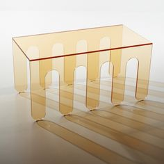 #MILLEPIEDI B. Contoured coffee table in extra-clear laminated cut glass.