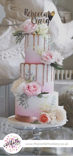 Pink ombré wedding cake with rose gold drips and fresh floral decoration. At the beautiful Aynhoe Park. Image: The Confetti Cakery.