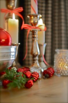 silver and red bokeh christmas ornaments with candle