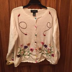 Celina Yang Designs sweater Celina Yang Designs sweater, beautiful details on white sweater and sleeves. This is new without tags, as I am 6' and it fits average length. Celina Yang Designs Sweaters Cardigans