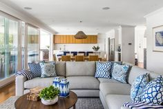 Get the look : contemporary living room of blue + white throw pillows on a natural linen sectional