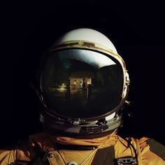 Astronaut photograph with cabin reflected in helmet
