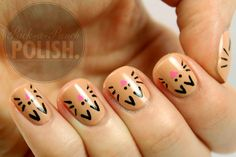 The base polish I used to create this design is Exposed by Motives. It's a gorgeous nude shimmer and I love it! For the cat faces I used black and pink acrylic paint and a very small nail art brush.