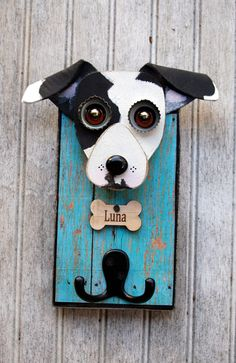 Dog leash holder, customized for you pet.. Cute and practical, this leash holder combination measures approximately 8 x 6, All the wood is recycled or culled to create a functional piece of art. On the back is a heavy duty key hook to assure proper hanging with bumpers to protect your wall. Each piece is hand cut and painted. What I need from you is a couple of good frontal head shots of your fur baby. Convo me with any questions.