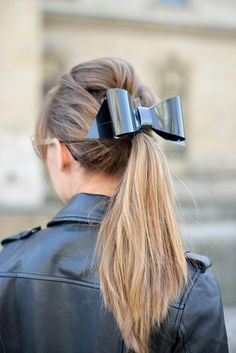 This modern bow hair accessory looks great styled with an edgy leather jacket | How to Wear Bows as a Grown Adult Woman | StyleCaster