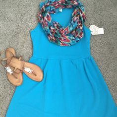 Turquoise self esteem dress with scarf! This dress is brand new with tags never worn comes with the scarf!! It is very cute and versatile great for the season ...size is L and the brand is self esteem. Self Esteem Dresses Mini