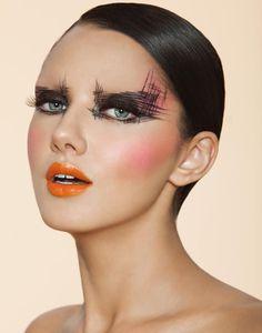 Black eye makeup orange lips