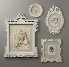 This would be adorable in a baby's room... peter rabbit, love the vintage frames and prints.