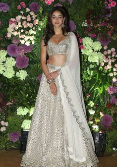 Ananya Panday wore a cream and white lehenga in which she looked gorgeous. Indian Gowns Dresses, Indian Fashion Dresses, Indian Designer Outfits, Celebrity Wedding Dresses, Designer Bridal Lehenga, Designer Party Wear Dresses, Party Wear Lehenga, Indian Bridal Outfits, Indian Celebrities