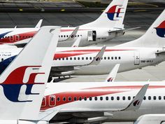 """Two pieces of wreckage """"almost certainly"""" from missing Malaysia Airlines flight."""