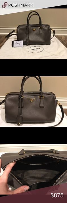 Authentic Prada Lux Convertible Boston Bag Authentic Prada Lux Convertible (BL0796) Boston Bag Saffiano Leather in Graphite  Product Features: - Graphite saffiano leather - Dual-rolled leather handles - Detachable shoulder strap - Protective base studs - Gold-tone hardware accents - Zip closure  This also includes Authenticity Card and Dust Cover gently used tote, but still is great condition. There is a small amount of wear on the bag and the zipper pull. (Shown in photographs).   Original…