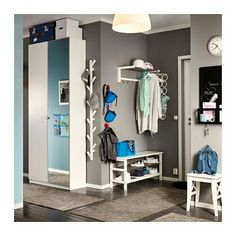 A Grey Hallway With A White Hat Rack, A Tree Shaped Wall Hanger And A Shoe  Rack That Holds 8 Pairs Of Shoes. Shown Together With A Wardrobe With One  White ...