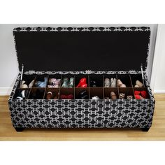 Decorate your bedroom or entryway with this fashion-forward shoe storage bench. Upholstered with black fabric and accented with a white chain link pattern, this uplifting ottoman opens to reveal storage slots for your boots, pumps and sneakers.