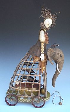 Very cool doll-elephant-caged birds on wheels contraption