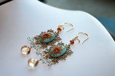 Glowing Blue Topaz earrings with Mystic champagne by Peelirohini