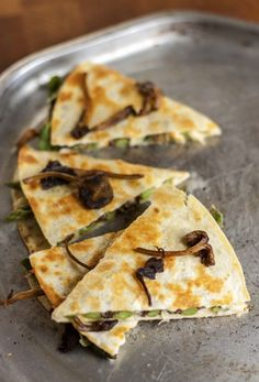"""Wild Mushroom, Asparagus & Arugula Quesadilla. We've called this dish a """"quesadilla,"""" since that's a word that is familiar to most of us. Made with soft, easy-melting cheese and flour tortillas, it closely resembles a Mexican quesadilla, but contains no chile peppers, salsa or any of the usual spices. It's really more like a sort of savory crepe, filled with buttery-nutty yellowfoot mushrooms, tender-crisp asparagus and peppery arugula, all united by the creamy goodness of gooey melted…"""