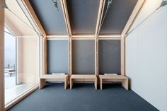 """The building's restrained color and material palettes carry over to the minimalist wood benches in the reception area. Since the facility must withstand heavy usage as well as inclement weather, it was built with """"easy maintenance"""" in mind, according to Girodo."""