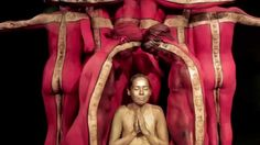 New York City-based body painting artist Trina Merry has created a human Tibetan-style temple made up of 17 naked circus performers and danc...