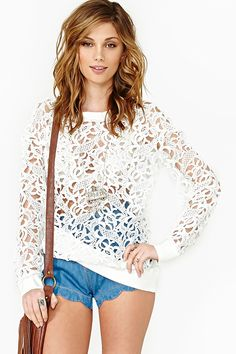 Thrill Of The Lace Top: Super cool sweatshirt-inspired white top featuring a scoop neckline and sheer lace detailing. Ribbed at cuff, neck, and hem. Loose fit. Looks rad tossed on with hot shorts and a leather cap!