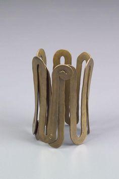 Bracelet |  Alexander Calder.  Brass wire.