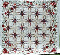 DWR on the quiltsalot blog.  I found on Gayle Pindley's board but searched for a photo of the whole quilt.  Let's think about this one for awhile....