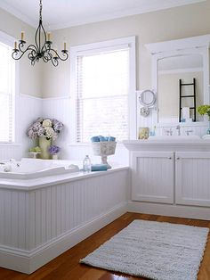 White tile tub surround instead of wood so it won't warp.