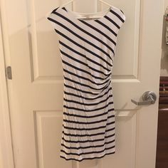 Loft striped, ruched dress Loft dress with flattering ruching on the side. Navy and white striped pattern. Very good condition. Lining is 100% polyester. Body is 70% rayon and 30% tencel. LOFT Dresses