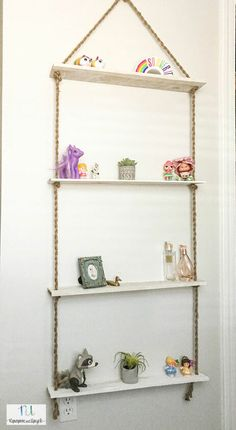 Have you ever DIY'ed your own shelves? I'm always surprised at the cost of open shelving, especially since they are so popular and easy to make. Yesterday I was… Film Logo, Basket Shelves, Rope Shelves, Hanging Shelves, Diy Hanging, Nursery Bookshelf, Reclaimed Doors, Bee Boxes, Diy Playbook
