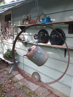 old gas can + barrel ring yard art by Christina Anderson