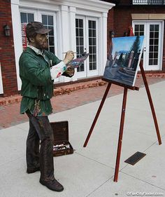 Photo of a J. Seward Johnson sculpture of a man painting a picture in downtown Carmel Indiana Westfield Indiana, Seward Johnson, Sculpture Art, Sculptures, Carmel Indiana, When I Dream, Wedding Honeymoons, Places Of Interest, Beautiful Sunset